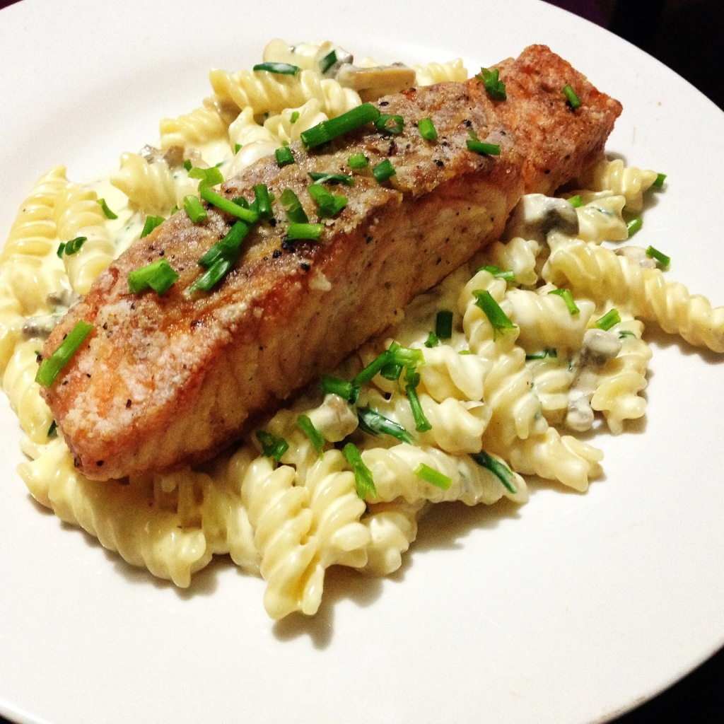 Crispy Salmon On A Bed Of Creamy Cheesy Mushroom Pasta Sprinkled With Chives