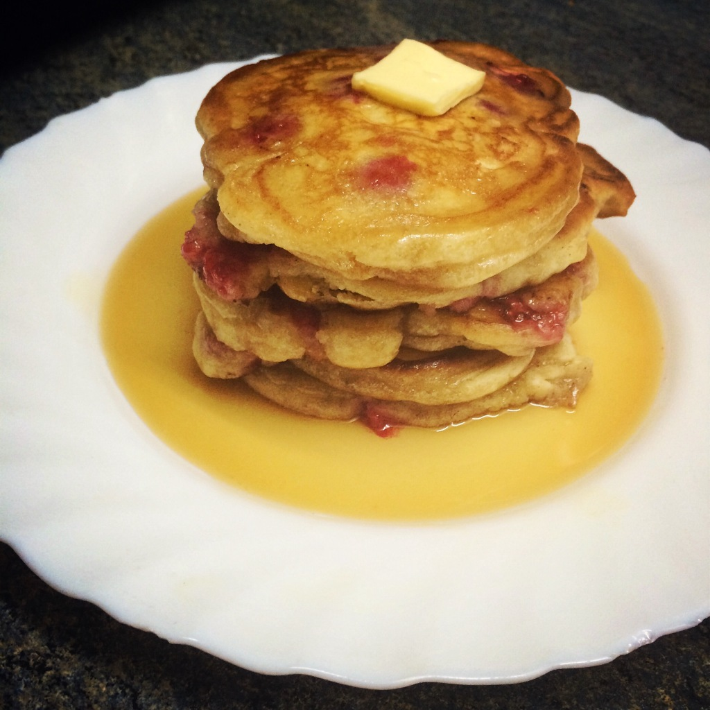 Raspberry Pancakes With Butter and Maple Syrup
