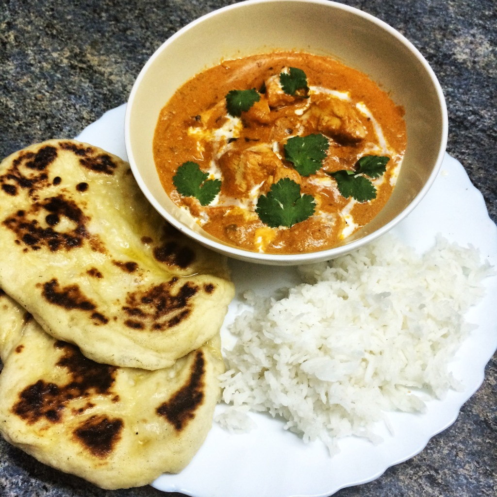 Butter chicken with homemade naan bread