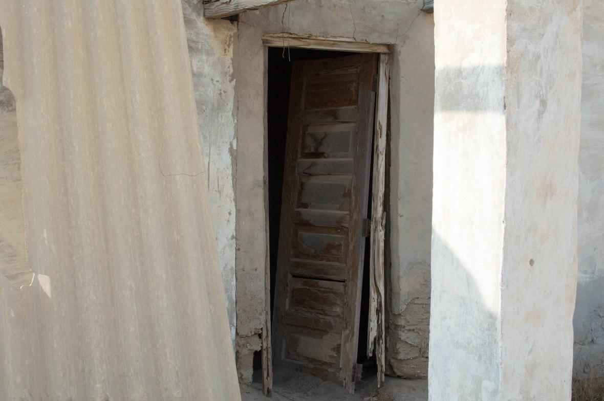 Broken Front Door, Abandoned City, Al Jazirat Al Hamra, Ras Al Khaimah, UAE