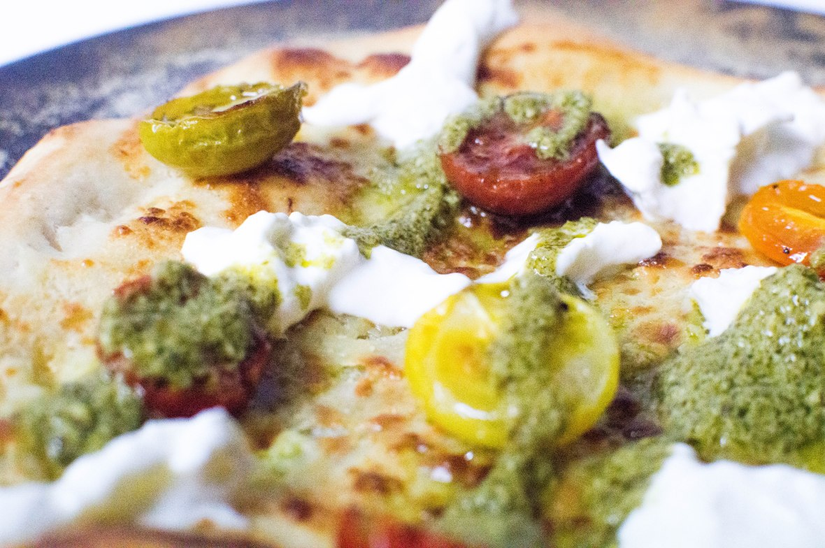 Burrata, Slow Roasted Cherry Tomato and Pesto Pizza On A Cream Base