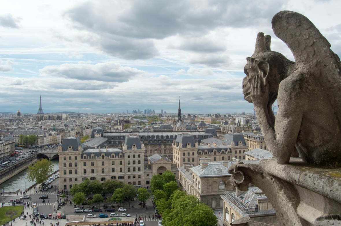 Gargoyle Watching The Eiffel Tower, Notre Dame, Paris, France