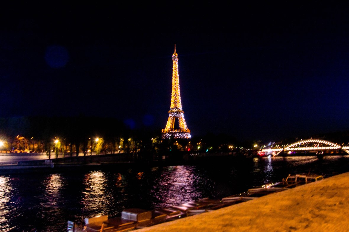 View Of Lit Up Eiffel Tower From Pont de l'Alma By Nightfall, Paris, France