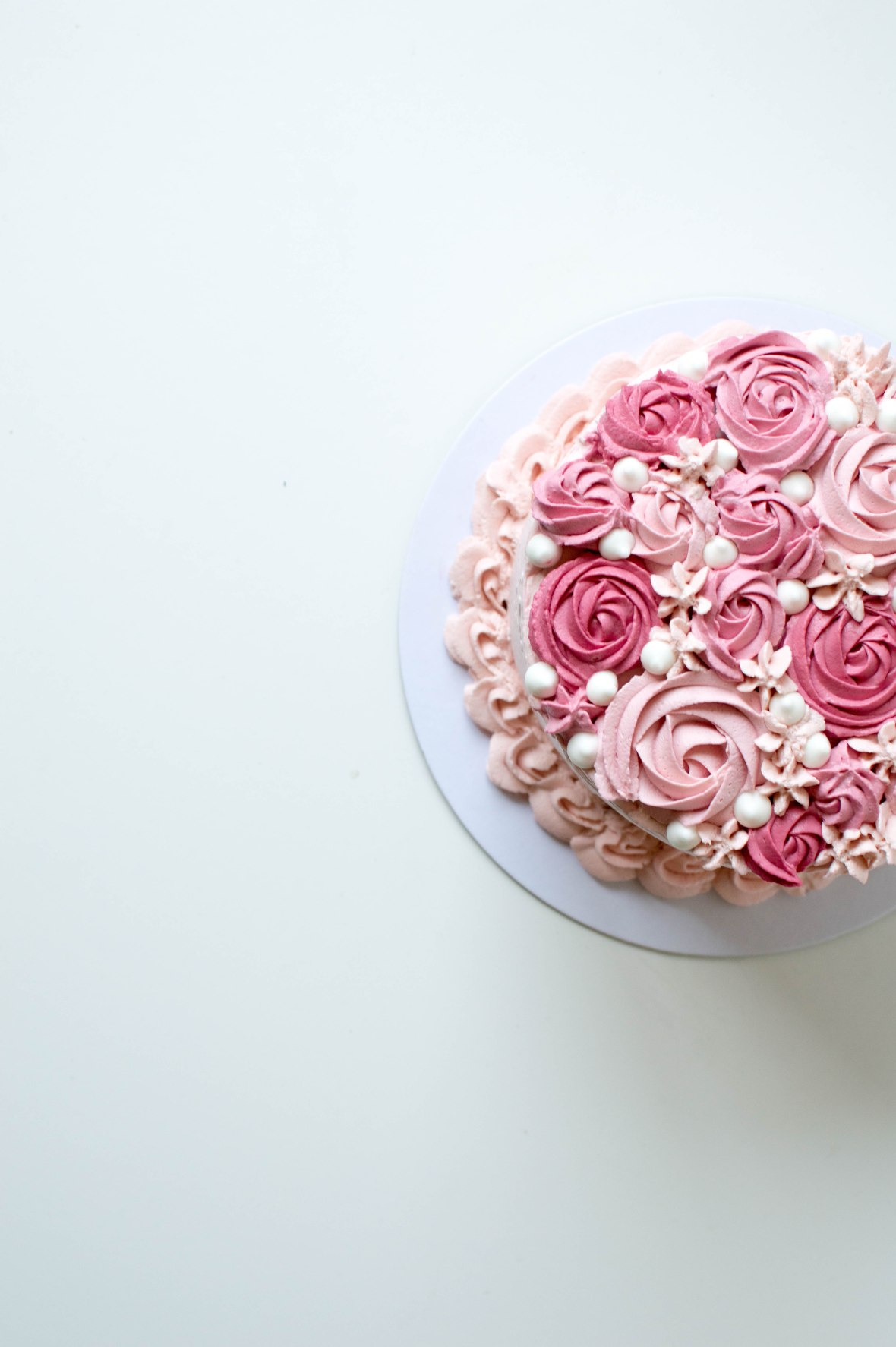 Rose Icing On A Pink Raspberry Cake - Kay's Kitchen