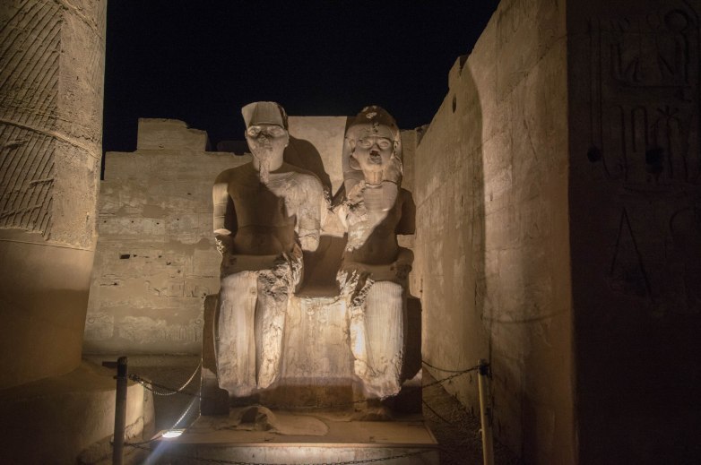 Statue of King Tut (Tutankhamen) & His Wife Ankhsenamunat the Luxor Temple By Nightfall